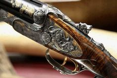 double barrel safari rifles | Rod & Barrel • This double barrel rifle with the African motifs...