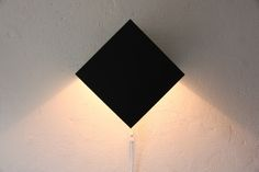 Light Object is made of 1.5-mm folded steel and has sprayed-on duo tones in black, grey, and white