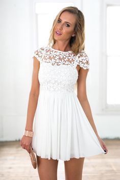 Oh so sweet lace & tulle detail dress!  Cap sleeve embroidered lace bodice with sweet heart neckline underlay  Tulle skirt detail with lining  Slightly pleated from the waistline  Exposed centre back zip opening