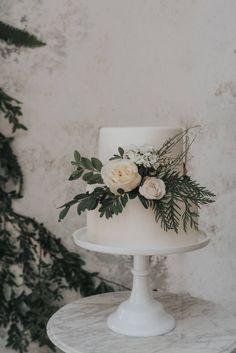 Simple and elegant wedding cake inspiration | white cake | dessert ideas | Romantic Modern Mountain Elopement in Banff via Rocky Mountain Bride #ModernWeddingIdeas