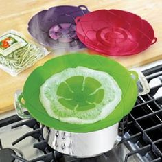 I need these!   Prevent overflows with this Boil-Over Spill Stopper lid.
