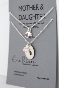 This set of necklaces perfectly represents the bond of love between mothers and daughters, combined with cancer awareness. Handmade of sterling silver.