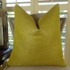 The front fabric of this trendy metallic sofa #pillow is a blend of cotton, polypropylene and viscose in metallic citrine and gold colors. Available at $ 98.00