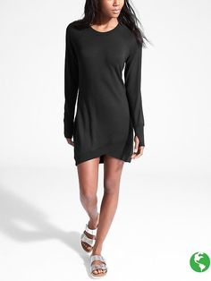 """Cozy black dress, with a  little """"lift"""" at the hem."""
