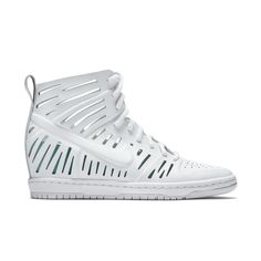 """Nike Dunk Sky Hi Bella  - ELEVATED STYLE AND COMFORT  The Nike Dunk Sky Hi Bella Women's Shoe features cutouts in the leather upper and a concealed wedge heel that takes an iconic shoe to new heights. A cushioned midsole offers plush comfort.  Benefits    Leather upper with geometric cutouts for premium style and breathability  Injected Phylon midsole for lightweight cushioning  Hidden2.6"""" wedge heel for a feminine yet sporty silhouette  Rubber outsole for durability and traction    Dunk…"""