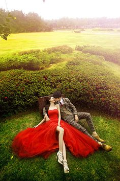 A Lovely Red Wedding Dress In Very Green Setting