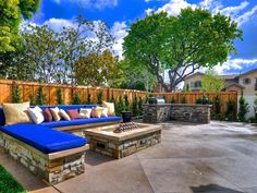Patio with built-in seating, fire pit, and outdoor kitchen/bbq