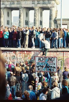 """""""Attention! You are now leaving West Berlin.""""    Germans crossing the Berlin Wall, a symbol of oppression that separated West Berlin (Federal Republic of Germany) from the rest of East (Communist) Germany, until in 1989, when people power forced the East German government to allow people to freely pass through the wall. People took chunks off the wall, and so in 1990, the remainder of the wall (and of the communist government) was removed. Germany achieved re-unification on 3 October 1990."""
