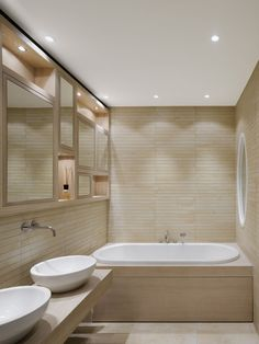 Small Bathroom Lamp Design With Pretty White Oval Bathtub wood tile wall and floor and floating vanity with double vassel