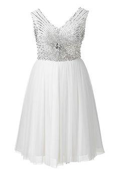 Brides.com: 21 Stylish, Short Plus-Size Wedding Dresses Short embellished dress, $185, Simply BePhoto: Courtesy of Simply Be