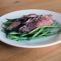 Your Healthy Valentine: Wine-Poached Steak With Haricots Verts: This inventive method of poaching lean flank steak in red wine takes a little patience, but the results are worth the effort.
