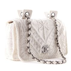 "Chanel White Crochet Flap Bag Perfect spring/summer bag! Pre-owned CHANEL flap bag made of white crochet fabric.  Two chain straps sit comfortably on your shoulder. Fabric interior has one zip pocket. White crochet knit with silver-tone hardware including CC logo on the flap and chain/leather entwined shoulder straps. Magnetic snap closure on the front flap. Material: Cotton Hardware: Silver Measurements: 6""(H) x 9""(W) x 2.5""(D) Pls refer to 2nd listing for more photos. I ONLY TRADE FOR…"
