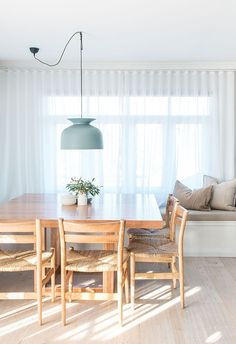 modern beach house renovation by The Block's Kyal and Kara // very neutral and simple dining room with a few muted pastel accents, but mostly white with a wood dining table and woven chairs - My Home Decor Decor, Modern Beach House, House Styles, Interior, House, Home Decor, House Interior, Wood Dining Table, Dining Table