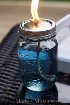 These easy and inexpensive DIY citronella candles are made with torch fuel, lamp wicks and mason jars for an effective deterrent for bugs!