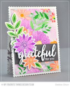 "MFT_Funky-Flowers1a_Deb-Olson. Bundles of Blossoms Background, Funky Flowers, and Grateful for You.I stamped the Bundles of Blossoms background on watercolor paper with Versamark ink,  heat embossed the image with detail white embossing powder, and then watercolored the image with Zig Clean Color Brush Markers. Next I stamped a few of the images from Funky Flowers, painted them, and die-cut them with their coordinating Die-namics. I cut four layers of the ""grateful"" sentiment with the…"
