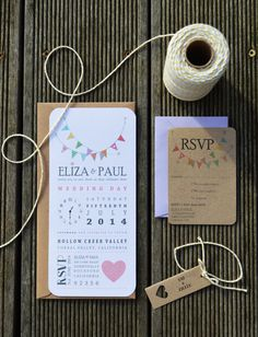 A beautiful pastel and kraft rustic wedding invitation suite printed on white…