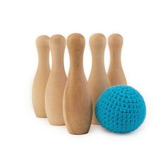 bowling game with blue ball, wood skittles and soft crochet ball, and other wooden toys