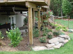 These large stones help to stabilize the soil and give structure to the backyard. Repin if your yard could use a subtle #planterbed like this! | Northern Virginia | Drainage & Erosion Solutions