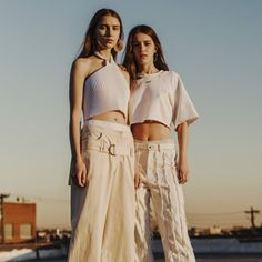 From left: Faustine Steinmetz top, $200, openingceremony.us; Rosie Assoulin pants, $1,295, Serenella, Boston, 617.262.5568; Y/Project gold-plated earrings, $104, openingceremony.us; Vans sneakers customized by Matthew Adams Dolan, collection at matthewadamsdolan.com. Off-White c/o Virgil Abloh cropped T-shirt, $330, Barneys New York, New York, 212.826.8900; Balenciaga pants, $3,500, similar styles at Balenciaga, New York, 212.206.0872; Lana Jewelry earrings, $795, neimanmarcus.com; Calvin…
