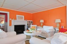 Wow!  Wish I were brave enough to paint my rooms tangerine and pink and yellow.  Very fresh and makes me want to eat Sherbet!!  Colorful cottage in Hyannis Port for sale 5
