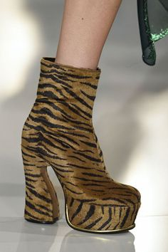 Keep your feet high and dry with '90s inspired platforms. These cheetah boots by Maison Margiela would make the Spice Girls proud, while patent leather versions can handle stomping through slushy streets.