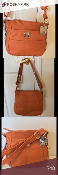 """🆕Tyler Rodan Crossbody Burnt Orange NWT This bag is a stylish organizational dream! Two slip pockets & 2 zippered pockets on the front; zippered pocket on top. Front snap close compartment & snap close main compartment w/ 2 slip & 1 zipped pockets. Adjustable strap. Pretty coordinated print lining. 12""""W X 10.5""""H X about 3""""D. NWT 🎀Bundle discount  🚭Smoke free home 🚫No trades please  😍 Thank you for shopping with me. Please ask all questions before purchase Tyler Rodan Bags Crossbody Bags"""