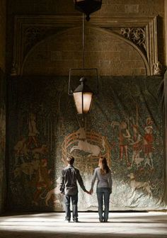 New still from Harry and Ginny holding handsoutside ofthe Room of Requirement