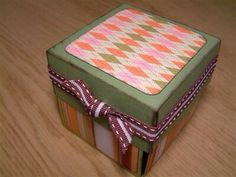 Decorate using scrapbooking or wrapping paper and ribbon