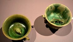 Tang dynasty green-splashed cups with three-dimensional turtle and fish at the bottom that would have been revealed when the beverage was drunk, found among objects recovered from the Belitung Shipwreck. @ Asian Civilisations Museum, Singapore.