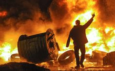 Protesters and police were locked in a tense standoff after ferocious clashes that turned an area of central Kiev into a virtual war zone, with police using tear gas, stun grenades and rubber bullets against protesters hurling stones and Molotov cocktails.