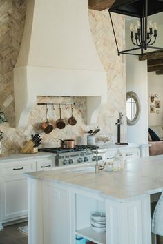 Timeless Country French House Tour to Inspire! Rustic elegant French country farmhouse kitchen with beautiful stucco range hood, copper pots, reclaimed Chicago brick backsplash, arabescato marble counters, and lanterns over island. Country Kitchen Farmhouse, French Country Kitchens, French Country Bedrooms, French Country House, French Country Decorating, French Cottage, French Farmhouse, Modern French Kitchen, Modern French Country