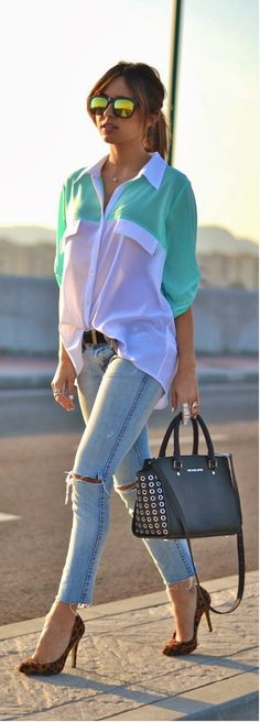 Medium spring green and white oversized shirt with sky blue stylish jeans and black leather hand bag and leopard heels