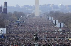 President Barack Obama's first inauguration drew a record 1.8 million people to the National Mall on Jan. 20, 2009. Planners say President-elect Donald Trump's inauguration is expected to draw 800,000, based on past attendance and data including hotel and restaurant reservations and chartered buses.