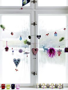 My daughter got a shrinky dinks set for her birthday! I have found something to do with them all! I have just the kitchen window that could use them!!