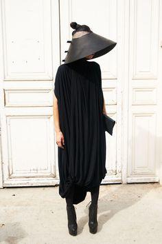 Lily Gatins wearing Cunnington & Sanderson 'Hail Mary' jersey dress.  Hat: Area Barbara Bologna Shoes: Cinzia Araia