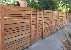 Modern, horizontal fencing with varying sized slats