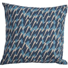 Add a pop of pattern to your favorite sofa or reading nook with this stylish cotton pillow, showcasing an abstract motif in blue hues.