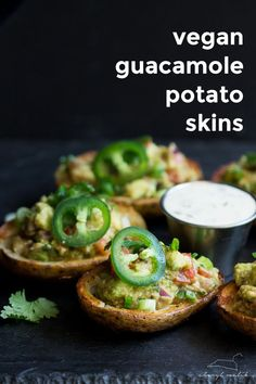 Vegan guacamole potato skins. Crispy potato skins topped with an incredibly flavorful, slightly smoky guacamole. Perfect for tailgating!