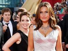 Pin for Later: 24 Celebrity Photobombs No One Saw Coming Tina Fey Tina was ready for Mariska Hargitay's close-up at the 2009 Emmys.