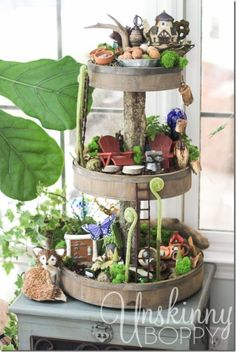 Woodland Fairy Garden from 3 Tier Stand Can you see all the fairies? If you look hard, we bet you can see a few in this unique container.