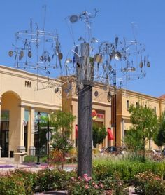 build metal wind spinners - Google Search Abstract City, Wind Spinners, City Streets, Public Art, Metal Art, Garden Art, Sculptures, Mansions, House Styles