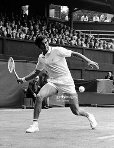 Ilie Nastase of Romania during the Great Britain v Romania Davis Cup tennis tournament played at the All England Club, Wimbledon, London, circa August 1969.