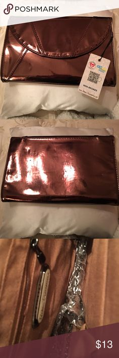 "Urban Expressions Shiny Large Bronze Clutch NWT. 100% Certified Vegan Leather. Optional Chain Strap. Fold over Magnetic Front Closure. 12"" W by 8"" H. Urban Expressions Bags Clutches & Wristlets"