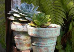 Painting terracotta pots.
