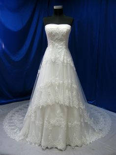 Vintage inspired lace wedding dress has sophisticated details the run around the train of the dress.
