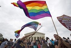 Supporters of gay marriage wave the rainbow flag outside the Supreme Court in July 2015. Photo by Joshua Roberts/Reuters