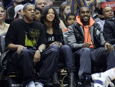 Jay-Z, Beyonce, and Kanye West seated courtside