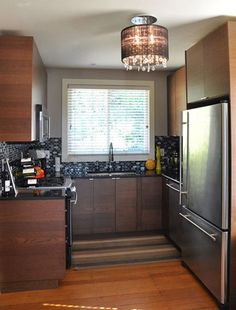 """Love the backsplash, light fixture, and the cabinets. This is the smallest """"big kitchen"""" it looks so efficient I think its great!"""
