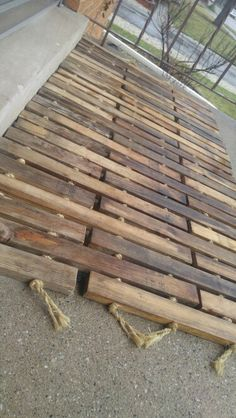 Recycled wood floor mat