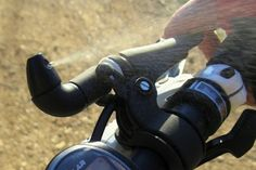 The #Q-Fog attaches to a bike's handlebars and allows bikers to cool down by misting themselves.